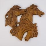 Horses in pierced relief