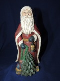 Santa with toys and small tree